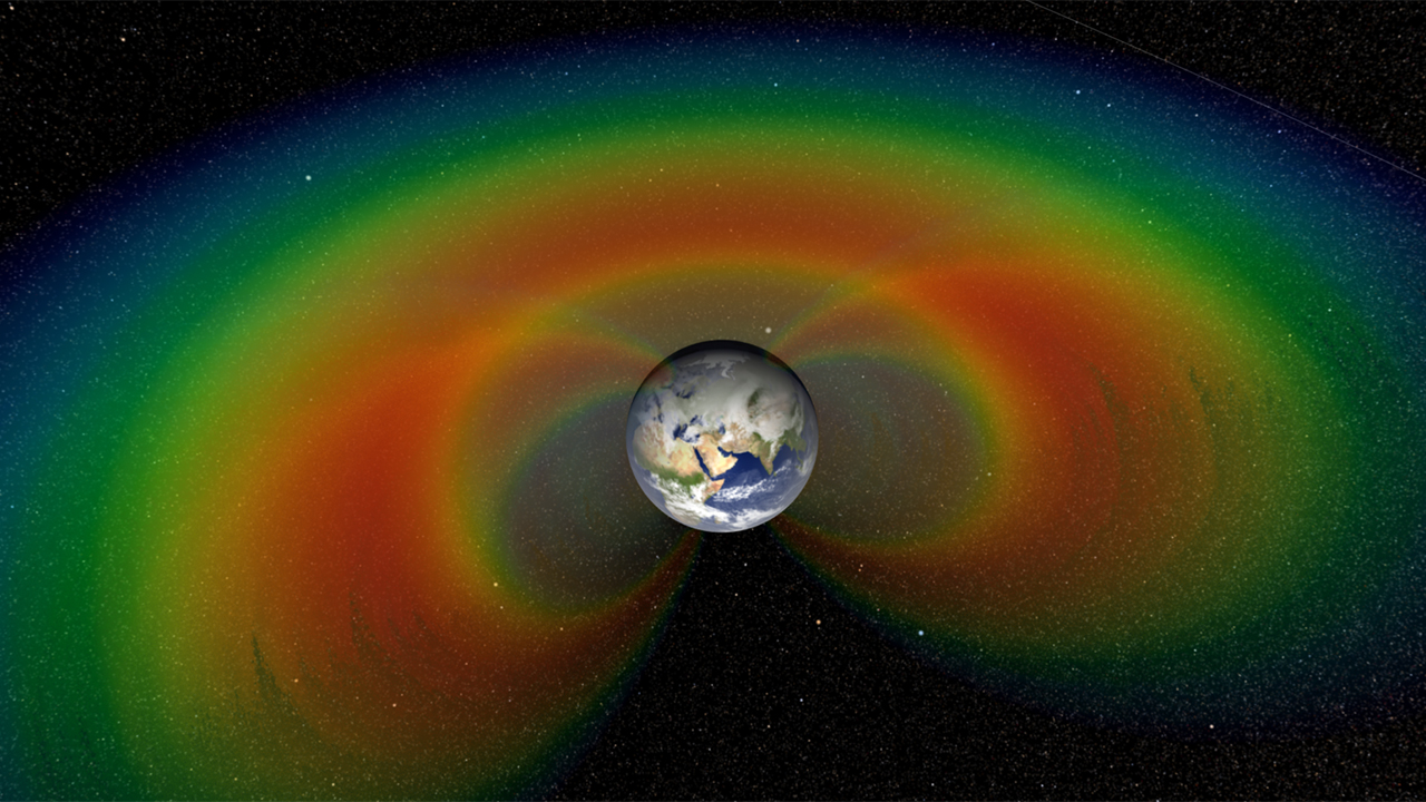 An artist's depiction with cutaway section of the two giant donuts of radiation, called the Van Allen Belts, that surround Earth.